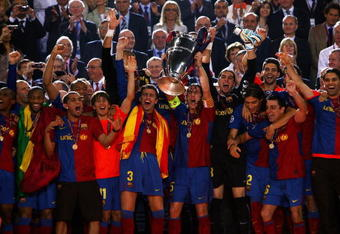 ROME - MAY 27:  Carles Puyol of Barcelona lifts the trophy as he and his team mates celebrates winning the UEFA Champions League Final match between Barcelona and Manchester United at the Stadio Olimpico on May 27, 2009 in Rome, Italy.  (Photo by Alex Livesey/Getty Images)