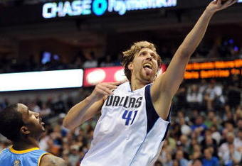 DALLAS - MAY 09:  Forward Dirk Nowitzki #41 of the Dallas Mavericks takes a shot against J.R. Smith #1 of the Denver Nuggets in Game Three of the Western Conference Semifinals during the 2009 NBA Playoffs at American Airlines Center on May 9, 2009 in Dallas, Texas. NOTE TO USER: User expressly acknowledges and agrees that, by downloading and or using this photograph, User is consenting to the terms and conditions of the Getty Images License Agreement.  (Photo by Ronald Martinez/Getty Images)