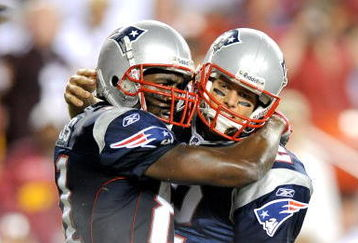 LANDOVER, MD - AUGUST 28:  Tom Brady #12 and Randy Moss #81 of the New England Patriots celebrate after scoring a touchdown in the second quarter of a preseason game against the Washington Redskins at FedExField on August 28, 2009 in Landover, Maryland.  (Photo by Greg Fiume/Getty Images)