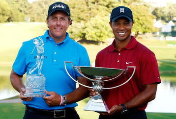 ATLANTA - SEPTEMBER 27: Phil Mickelson (L), winner of THE TOUR Championship presented by Coca-Cola poses alongside Tiger Woods, winner of the 2009 FedExCup at East Lake Golf Club on September 27, 2009 in Atlanta, Georgia. (Photo by Scott Halleran/Getty Images)