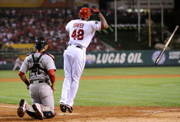 ANAHEIM, CA - OCTOBER 08:  Torii Hunter #48 of the Los Angeles Angels of Anaheim reacts to hitting a three-run home run as catcher Victor Martinez #41 of the Boston Red Sox look on in the fifth inning of Game One of the ALDS during the 2009 MLB Playoffs at Angel Stadium on October 8, 2009 in Anaheim, California.  (Photo by Kevork Djansezian/Getty Images)