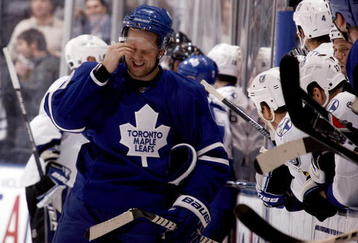 TORONTO - NOVEMBER 3: Phil Kessel #81 of the Toronto Maple Leafs regroups after getting hit by Mattias Ohlund #5 of the Tampa Bay Lightning during a NHL game at the Air Canada Centre on November 3, 2009 in Toronto, Ontario, Canada . (Photo by Abelimages/Getty Images)
