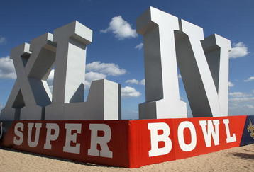 FORT LAUDERDALE, FL - FEBRUARY 6: A giant Super Bowl sign sits on Fort Lauderdale Beach on February 6, 2010 in Fort Lauderdale, Florida. Super Bowl XLIV between the Indianapolis Colts and the New Orleans Saints will be held Sunday February 7, 2010. (Photo by Jed Jacobsohn/Getty Images)